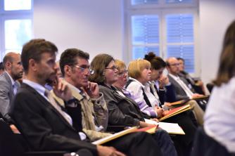 Foto von Teilnehmer*innen bei der Tagung 2016