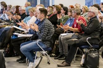 Foto von Teilnehmer*innen bei der Tagung 2018